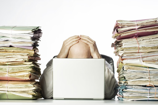 Office stress involving piles of work