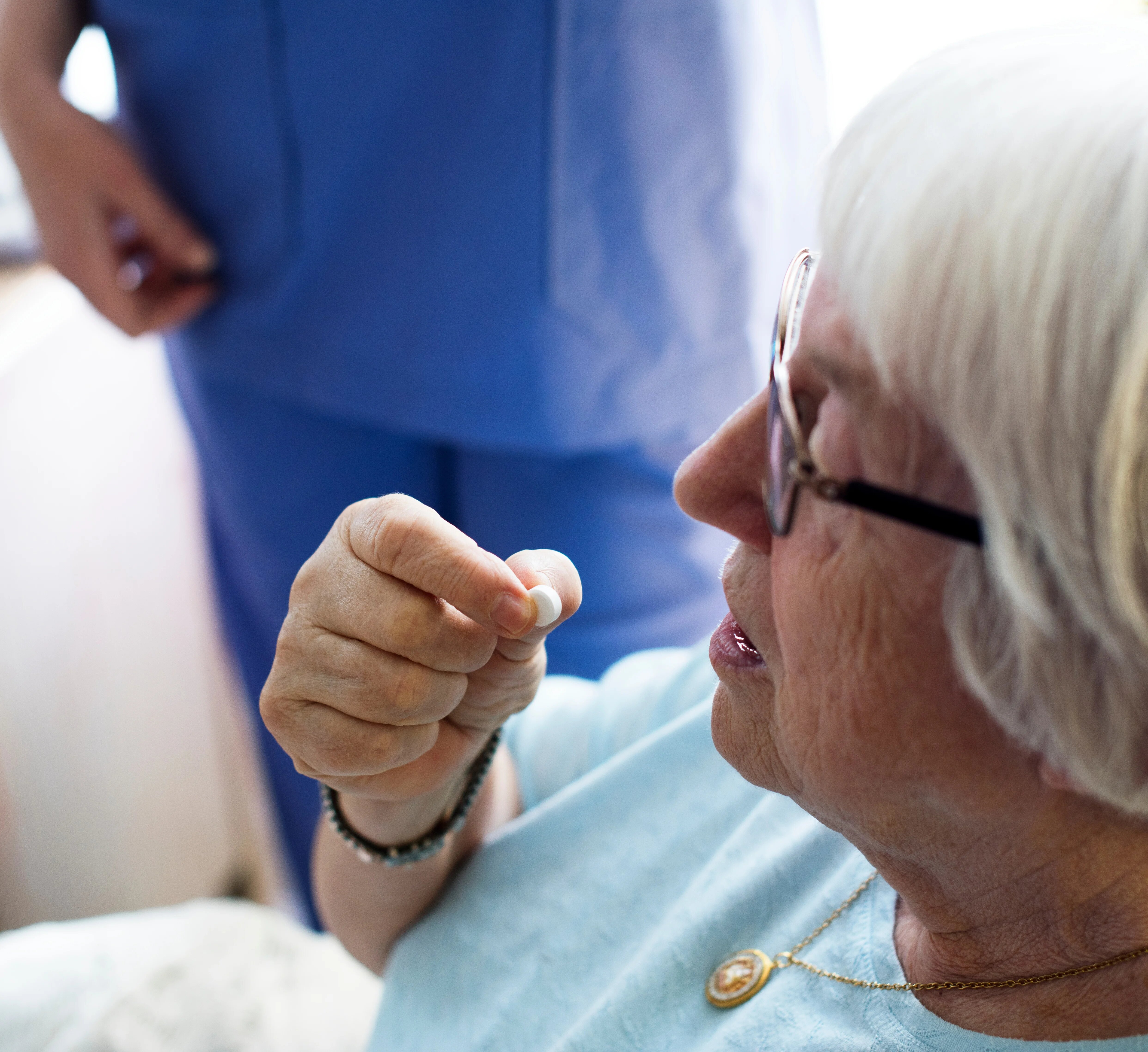 Patient taking medication in hospital.