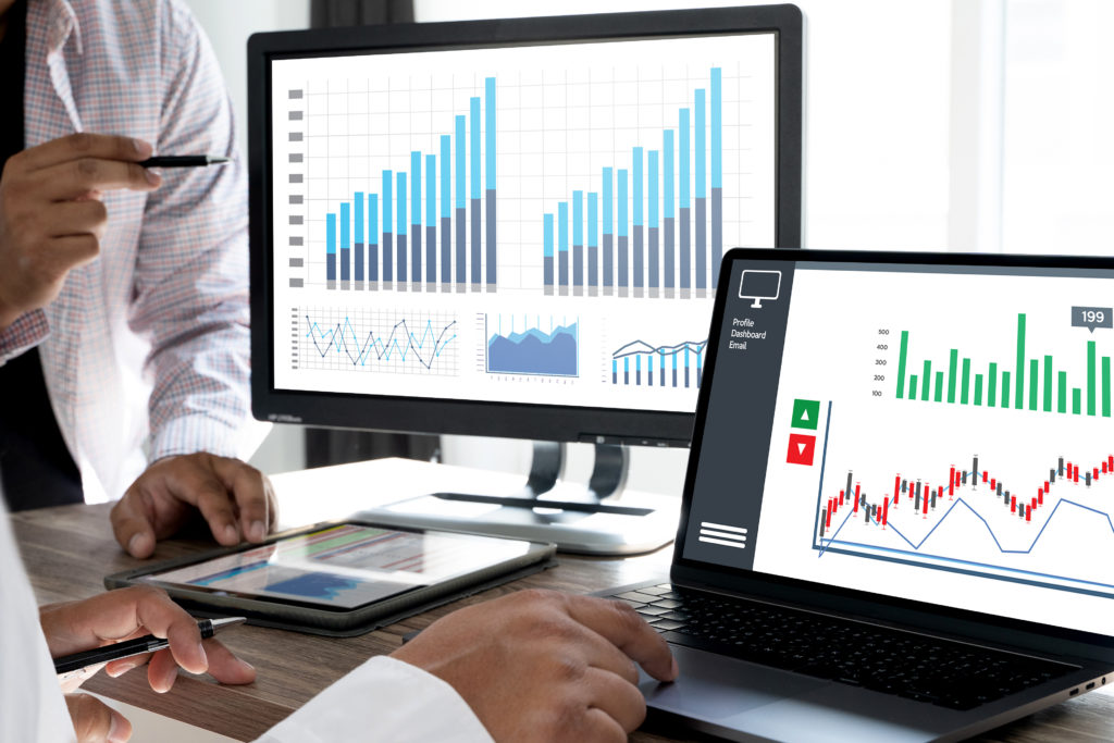 Clinical trial site managers looking at patient recruitment data