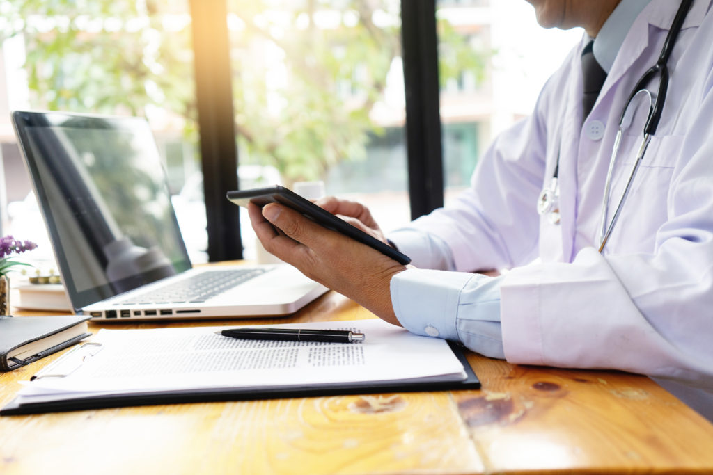 professional doctor use computer and tablet to work with the technology or digial health treatment.
