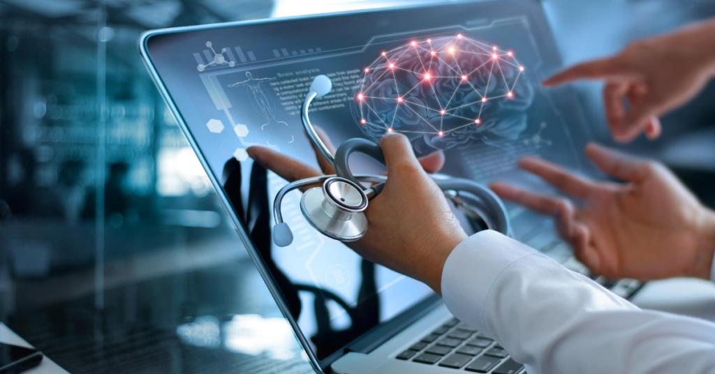 Physicians analyzing body sensor results on laptop.