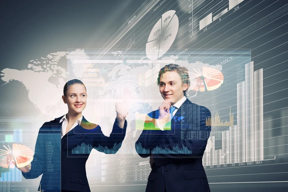 Businessman and businesswoman touching icon of digital screen