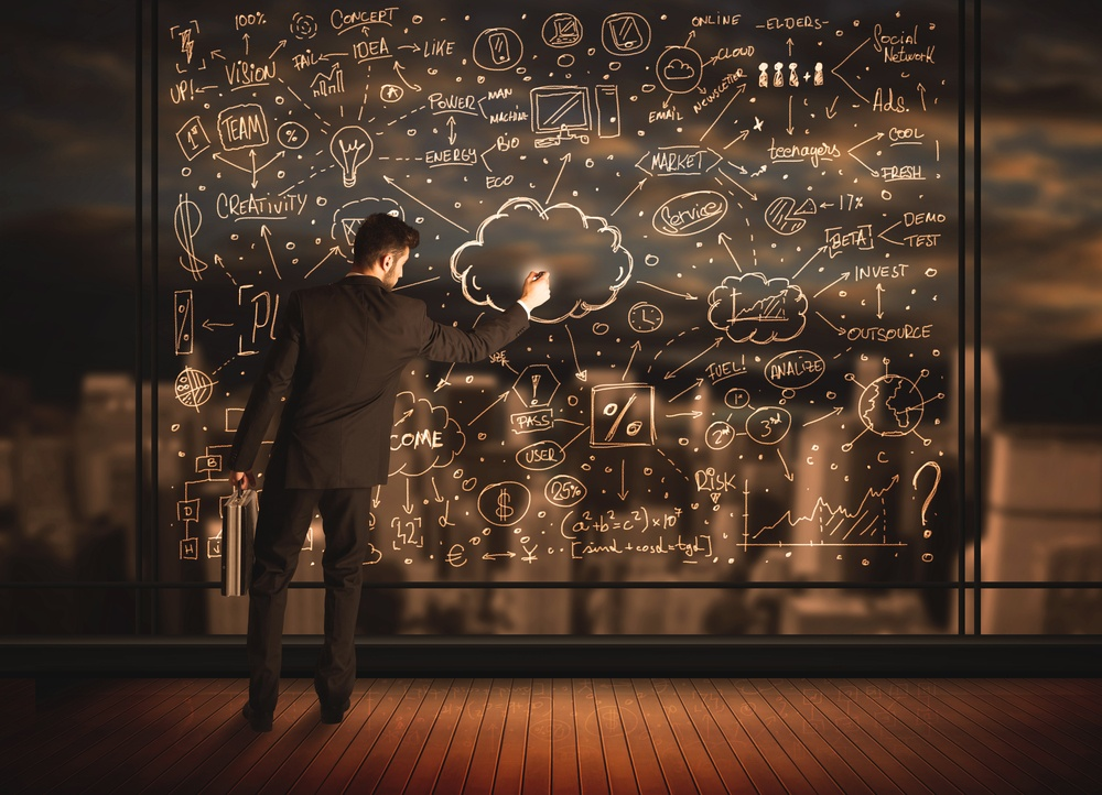 Businessman drawing business plan on glass window with bokeh background-1