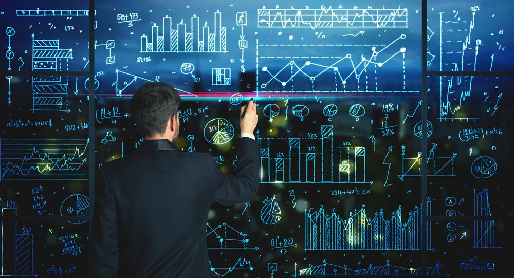 Businessman drawing business statistics on glass wall-2