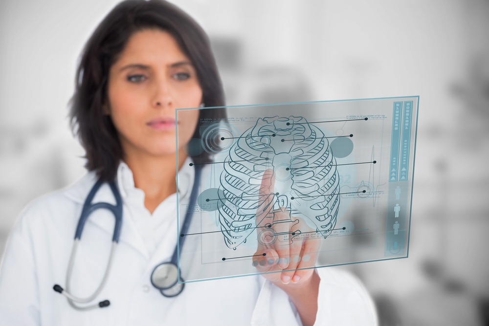 Woman looking at a medical interface in the hospital